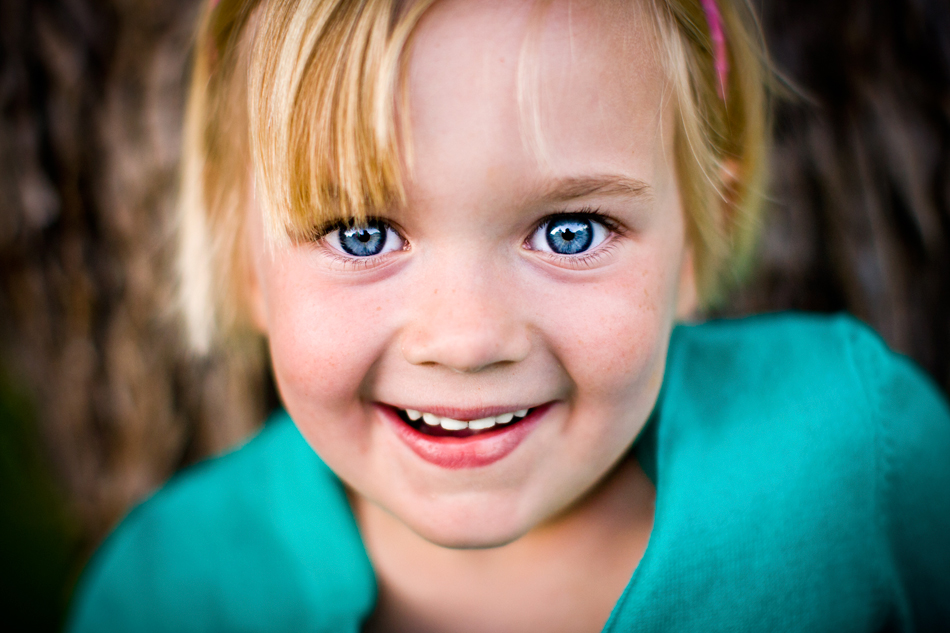 close up fun portrait of a young girl orange county family photographer