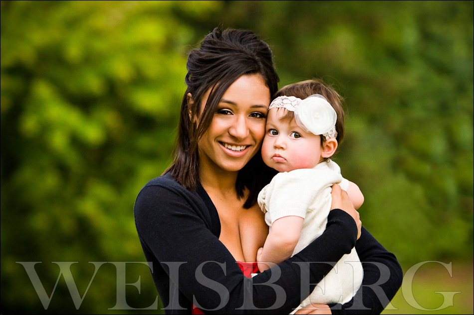 mommy and baby outdoor portrait in beautiful park
