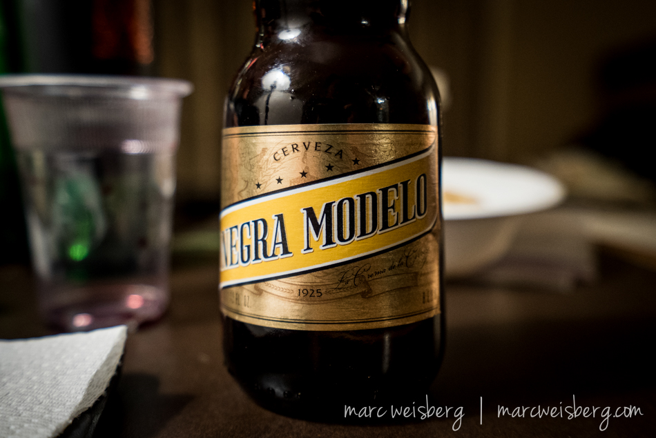 I don't drink beer often but when I do...I drink Negra Modelo:  a7s, 16-35mm f4 ZA OSS, ISO 4000 {not a typo}, f4, 1/60th sec.  Super clean at 4k ISO.